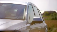 Grey vehicle driving field modern focus Car racing outside Stock Footage