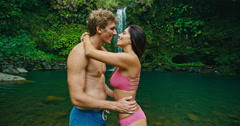 Couple Kissing at Waterfall Stock Footage