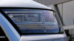 Grey car flashing light outside vehicle driving modern close-up Stock Footage