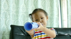 girl playing with toy musical instruments - stock footage
