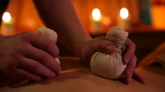 Herbal bags massage in spa salon Stock Footage