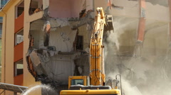 Video of excavator as a demolition machinery taking down a building Stock Footage