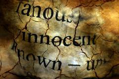 Innocent text on grunge background Stock Illustration