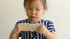 Little girl playing with puzzle Stock Footage