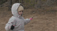 Little child walking in autumn forest Stock Footage