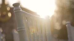 White chair in sun rays close up Stock Footage