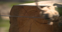 Sawmill machine cutting down a tree branch into a wooden beam Stock Footage