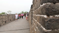 Tourists walk by the Great Wall in Mutianyu, China. Stock Footage