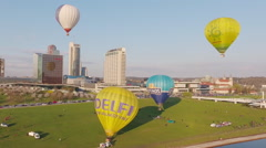 Lithuania, Vilnius cityscape on sunset, air baloons take off, aerial view. Stock Footage