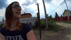 POV of girl in sunglasses comes and slowly closing iron gates Stock Footage