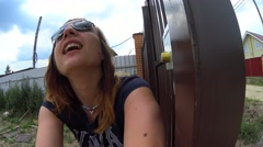 POV of girl in sunglasses slowly opening iron gates, camera rolling on doors Stock Footage