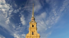 Peter and Paul Cathedral bells sound, tall golden spire against blue cloudy sky - stock footage