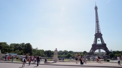 FRANCE, PARIS: People in front of famous Eiffel Tower, horizontal pan Stock Footage