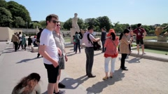FRANCE, PARIS: People posing near famous Eiffel Tower, horizontal pan Stock Footage