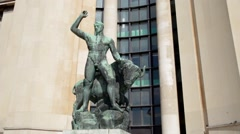 FRANCE, PARIS Classic sculpture near the old building. Statue of man with ox Stock Footage