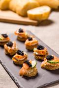 Smoked Salmon Canapes with Sour Cream and Caviar Stock Photos