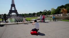FRANCE, PARIS: Eiffel Tower with girl who posing for picture Stock Footage