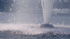 Fountain splash. Water drops splashing on water surface in slow motion - stock footage