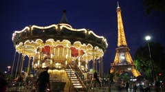 FRANCE, PARIS: Eiffel Tower and Carousel in evening time, time-lapse Stock Footage