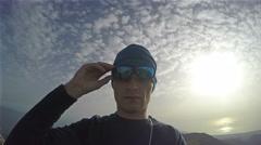 Man phisical preparation on top of Olympus mountain summit Mytikas in June wi Stock Footage