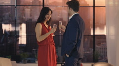 4K Young romantic couple drinking champagne & dancing in New York City apartment Stock Footage