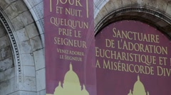 FRANCE, PARIS: A signboard on building, Montmartre, horizontal pan Stock Footage