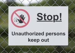 Stop Sign on Wire Fence Stock Photos