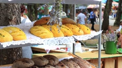 A fresh loaves of local breads at open-air food market Stock Footage