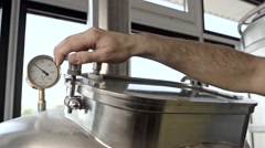 Man closes the valve in slow motion Stock Footage