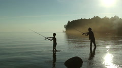 Father and son fishing on the lake. - stock footage