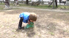 Little boy kisses a frog Stock Footage