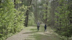 Mother and child walking in the forest ontario nature canada Stock Footage