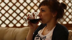 Woman drinks alcohol Stock Footage