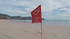 Red Flag on The Beachv -Phuket, Kata Beach, Thailand  Stock Footage