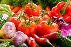 Composition with variety of fresh organic vegetables. - stock photo