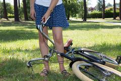 Female cyclists take her vintage bike out on a sunny day Stock Photos
