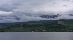 Rolling Clouds over Mountains and Lake Stock Footage