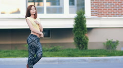 Young Sexy Beautiful Woman In Leggings Posing On The Street. Slow-Mo - stock footage