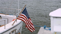 American Flag flying free on the back of a boat in Long Island New York Stock Footage