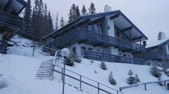 Snow falls on a two-storied house in winter forest, Sweden Stock Footage