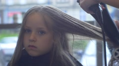 Beautician Dries Blonde Hairs Kid is a Client Hairdresser Salon Stylist is Stock Footage