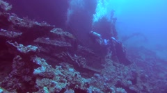 Male scuba diver inside the wreck of the SS Carnatic Stock Footage