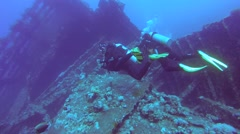 Male scuba diver at the wreck of the SS Carnatic Stock Footage
