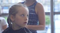 Girl Observes of Work of Skilled Hairdresser Stock Footage