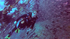 Female scuba diver inside the wreck of the SS Carnatic   Stock Footage