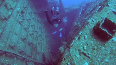 Two scuba divers at the wreck of the SS Carnatic Stock Footage