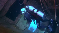 Male scuba diver inside the wreck of the Giannis D Stock Footage