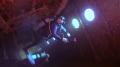 Two male scuba divers inside the wreck of the Giannis D Stock Footage