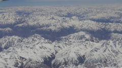 Aerial views in Tibet fly over to mountain Himalaya . View from the plane window Stock Footage