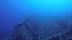 Male scuba diver at the wreck of the Giannis D Stock Footage
